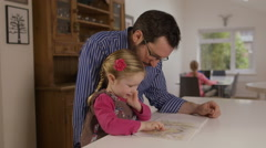 Father reads an interesting fairytale to his little daughter - stock footage