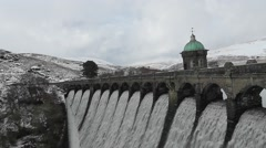 Craig Goch dam overflowing in winter Stock Footage