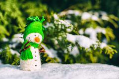 happy snowman on snow (copy space) - stock photo