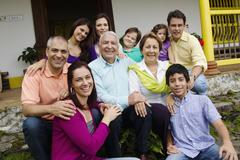 Hispanic family sitting on steps together Stock Photos