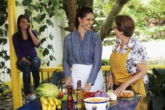 Hispanic family cooking together Stock Photos