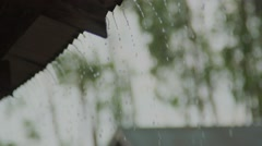 Rain falling from tin roof super slow motion Stock Footage