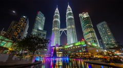 colored night famous towers fountain 4k time lapse from kuala lumpur - stock footage