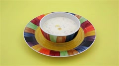 Video of pouring crackers into clam chowder Stock Footage