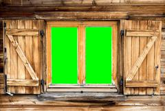 Mountain hut window green screen Stock Photos