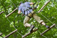 Climber high rope course 1 Stock Photos
