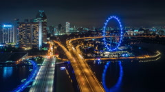 Night light traffic road and famous singapore city flyer 4k time lapse Stock Footage