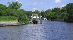 Boat On Lift Docked Along Florida River Stock Footage
