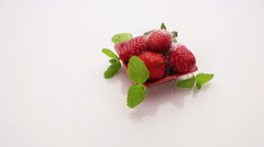 Strawberry sprinkle with sugar on fresh mint Stock Footage