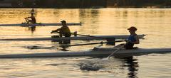 People rowing sculling boats on river Stock Photos