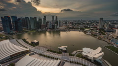 From sunset till night light 4k time lapse from singapore bay Stock Footage