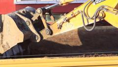 Dump truck being loaded with soil by shovel of the excavator Stock Footage
