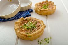 Onion mini quiche with bacon and corn - stock photo