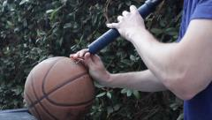Inflating Basketball Stock Footage