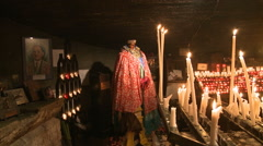 Shrine of Saintes-Maries-de-la-Mer with Sarah Kali statue and votive candles Stock Footage