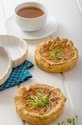 Onion mini quiche with bacon and corn Stock Photos