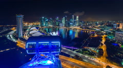 Night light singapore city flyer famous view 4k time lapse Arkistovideo