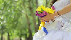 Bride is holding a bouquet - stock footage