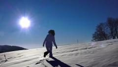 Hiker woman walking in the snow. expedition journey Stock Footage