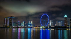 Singapore city night light famous view on hotel and flyer 4k time lapse Stock Footage
