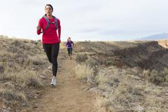 Hispanic runners training in remote area Stock Photos