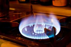 Flame on a gas stove in the kitchen. Stock Photos
