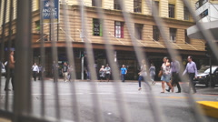 Anzac Square crowds through bars dolly zoom Stock Footage