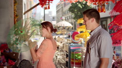 Happy young couple shopping in the city Stock Footage