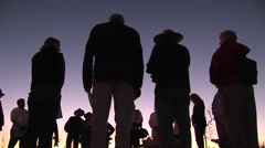A group of people stand in a circle talking. Stock Footage