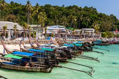 Longtail boats in tropical paradise Stock Photos