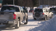 Truck crash into SUV on snow and ice covered street Stock Footage