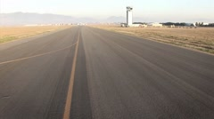 A helicopter flies over a long stretch of road. Stock Footage