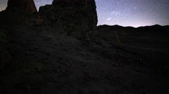 4K 3 Axis Motion Control Astro Time Lapse of Stars & Rock Formation -Tilt Up- Stock Footage