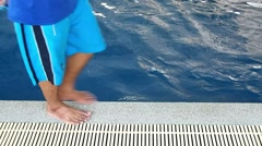 Golden retriever swimming in indoor swimming pool Stock Footage
