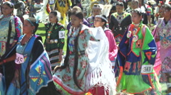 Fancy shawl dancers arrive during pow wow grand entry Stock Footage