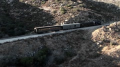 A train passes through a remote region. Stock Footage