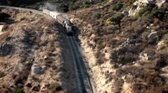 A train travels through a mountainous area. Stock Footage