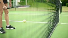 Unrecognizable Female Bouncing a Tennis Ball inside the Court Stock Footage