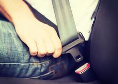 Man fastening seat belt in car Stock Photos
