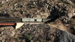 A freight train is traveling through a mountain tunnel. Stock Footage