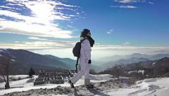 Backpack laden hiker woman on dangerous snow and ice covered mountain Stock Footage