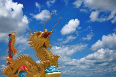 Golden dragon statue . Stock Photos