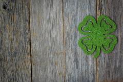 Glitter Shamrock on Rustic Wooden Background Stock Photos