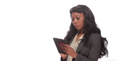 Young African American black woman using tablet pc computer - stock footage
