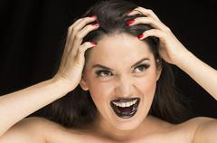 Young gothic desperate woman with red nails Stock Photos