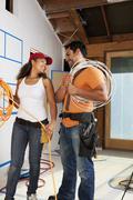 Hispanic couple wiring construction site Stock Photos