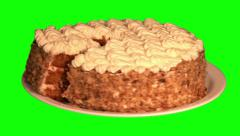 Cake with dried apricots, cream, crushed nuts with its piece on plate Stock Footage
