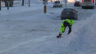 Stock Video Footage of Police officer caught on camera slipping and falling on ice