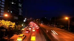 Traffic on a road in the city centre. Night time. Bangkok, Thailand. Timelapse Stock Footage