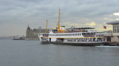 Passenger ferry departing from quay on a cloudy day  Stock Footage